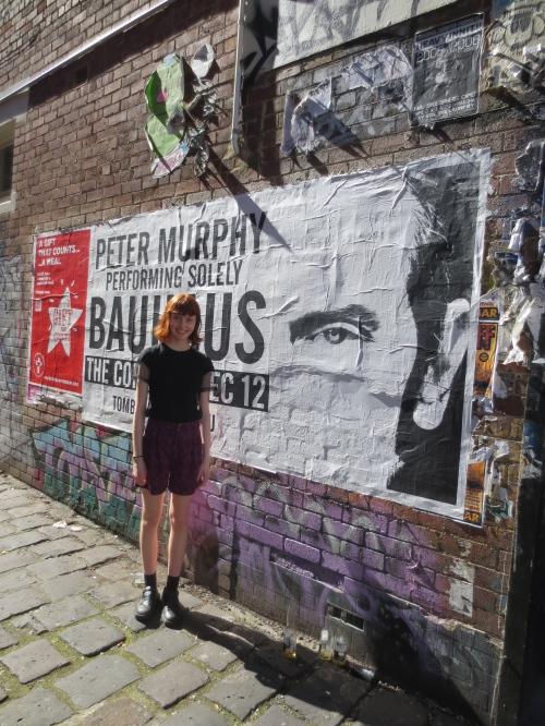 lara in front of graffitti
